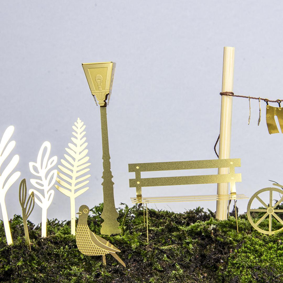 Botanopia-Tiny-Bike-in-the-city-brass-model